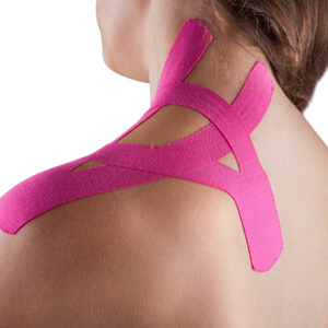 Woman with pink kinesotape on her shoulder