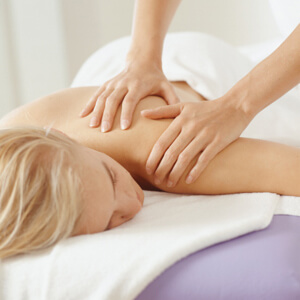 Young, blonde woman having massage