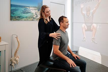 Dr Goodger examining a patient