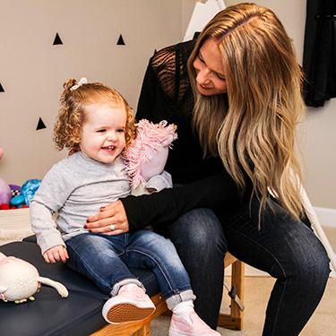 Dr. Katie adjusting little girl