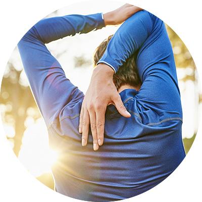 Man stretching arms