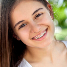 Teenager wearing traditional braces