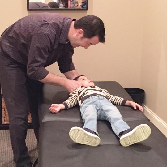Dr. Duff adjusting little boy