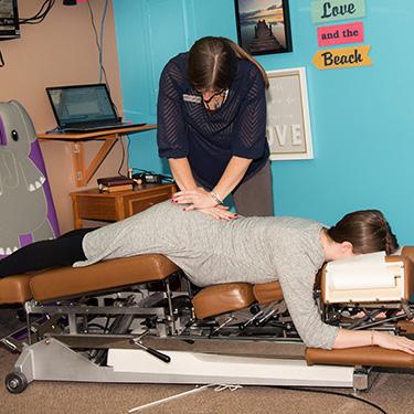 Dr. Little adjusting pregnant mom