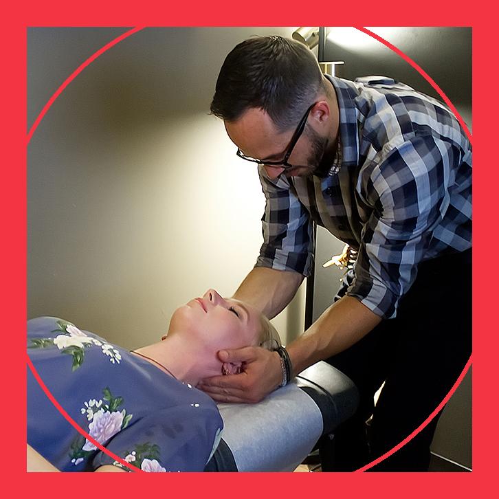 doctor massaging woman's neck