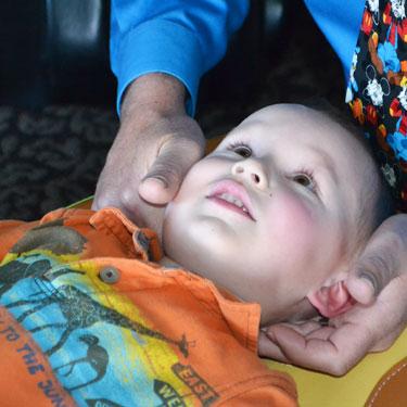 Dr. Mac adjusting young child