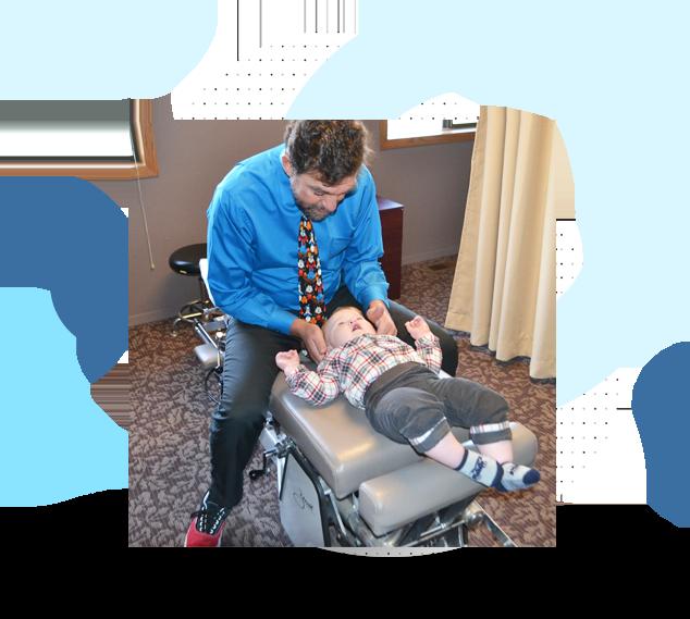 Dr. Mac Adjusting baby