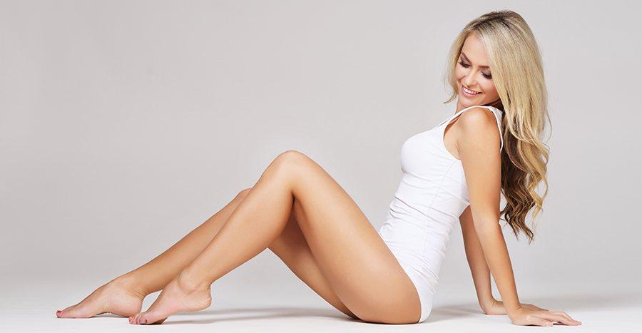 Happy woman sitting on floor