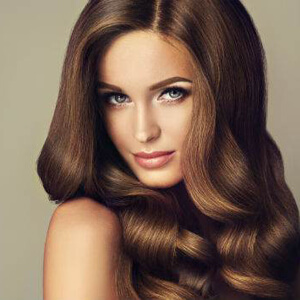 Beautiful woman with dark brown hair and blue eyes