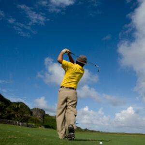 Back of golfer taking a swing