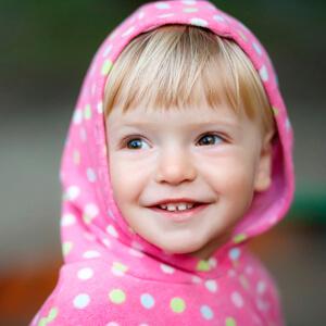 Little girl wearing pink hood