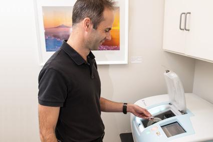 Dr Gray using CAD machine