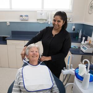 Dental nurse prepping patient for exam