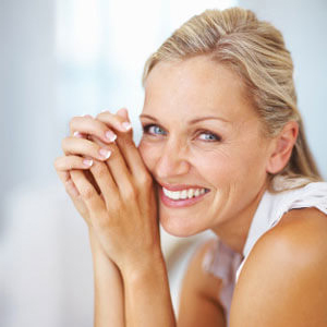 Middle aged woman with light hair and beautiful smile