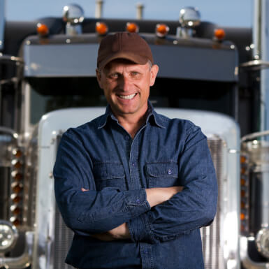 Man in front of big truck
