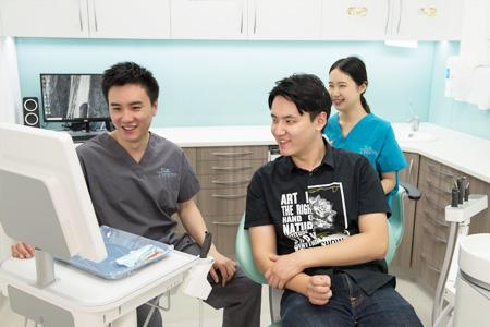 Dr Lam (Dentist) explaining procedure to patient