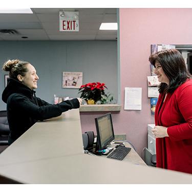Patient at front desk