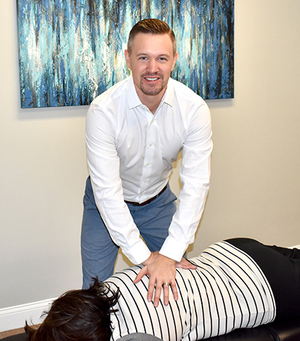 Dr. Gavin adjusting patient