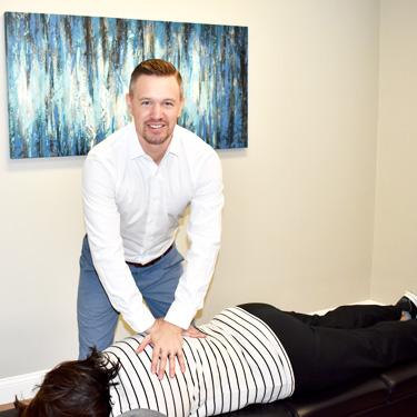 Dr. Gavin adjusting