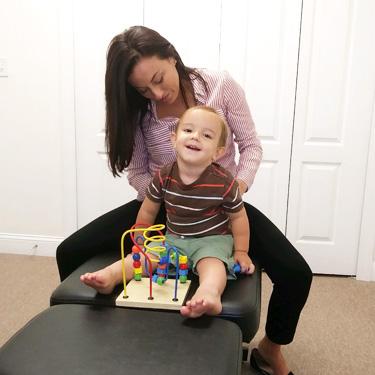 Dr. Suzi adjusting child