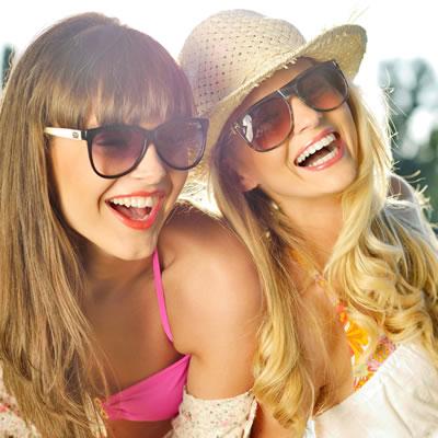 Teen girls open smiling wearing sunglasses