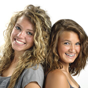 Two teenager girls, one with braces