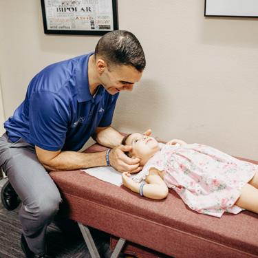 Dr. Jeremy adjusting toddler