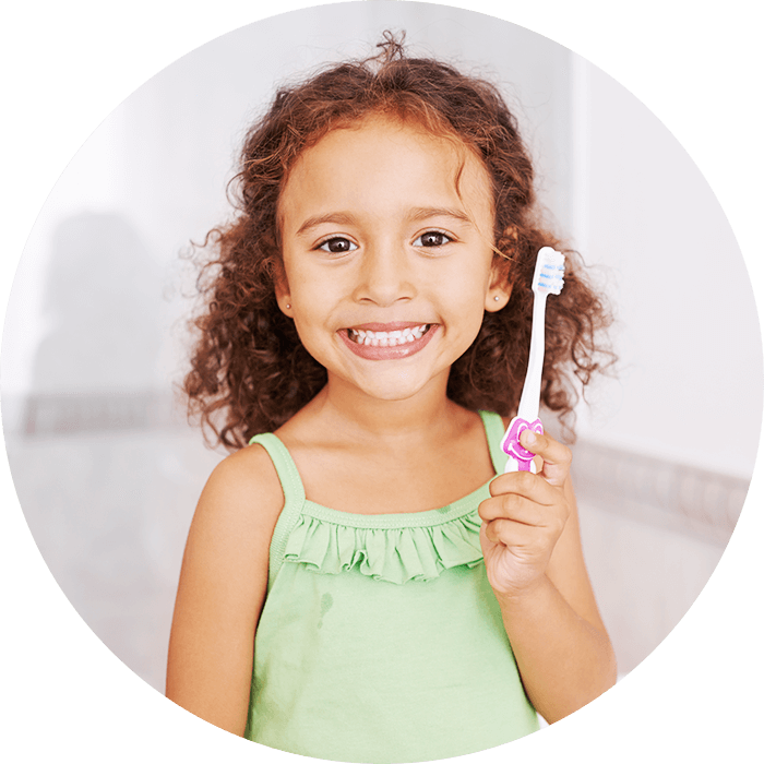child holding brush