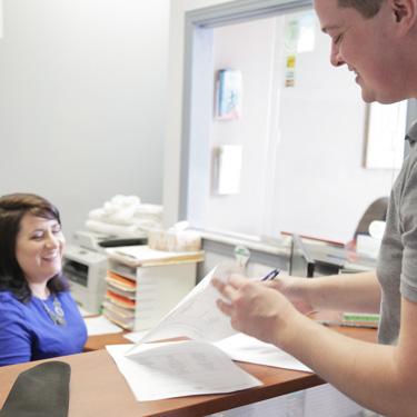 Patient looking at paperwork