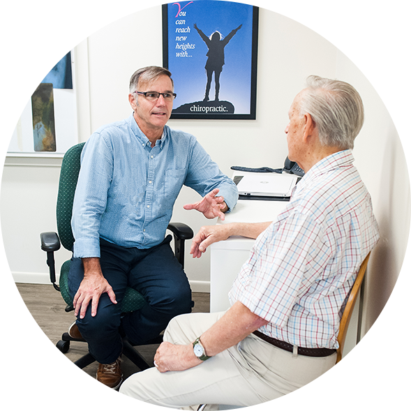 Dr Bernard Love (Chiropractor) chatting with patient