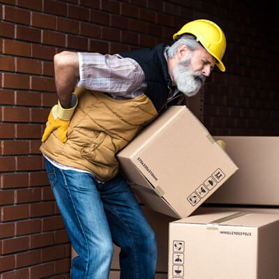 man working with boxes having lower back pain