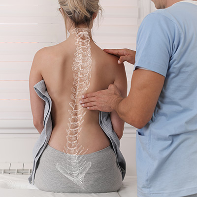 illustration of a spine overlaid on a woman's back