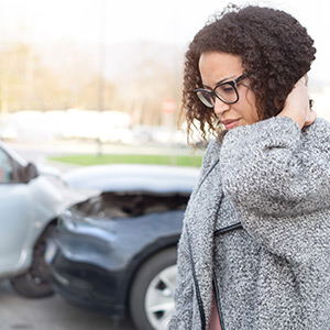 Woman holding her neck in pain after a car accident