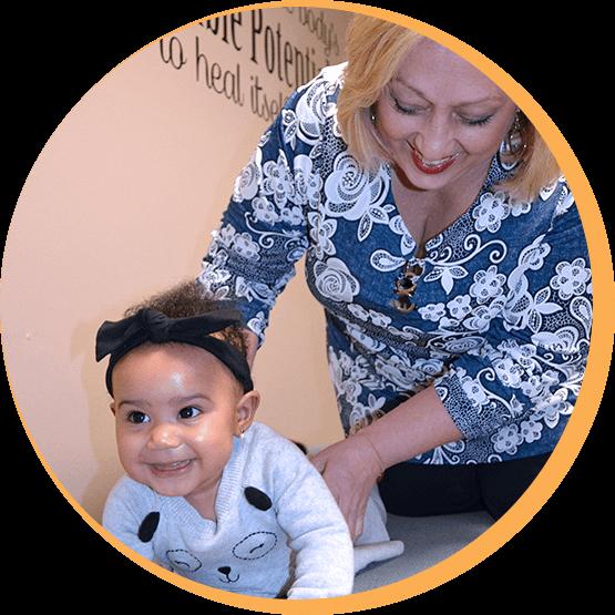 Dr. Michelle adjusting baby