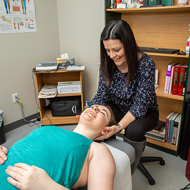 Patient getting cervical adjustment
