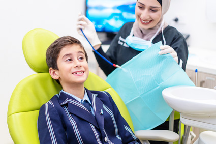 child-patient-and-dental-assistant