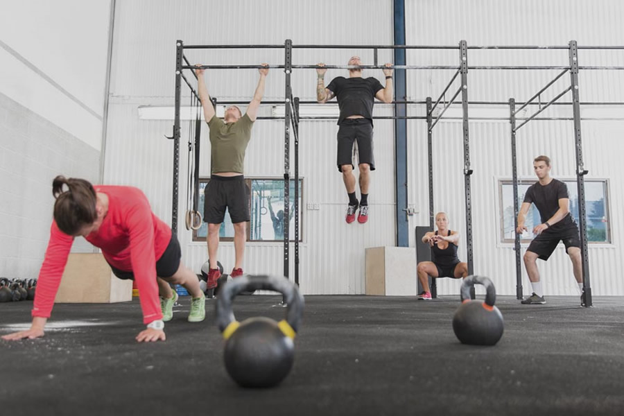 crossfit athletes workout in the gym