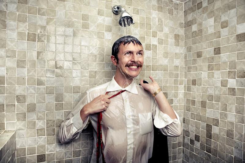Man taking cold shower