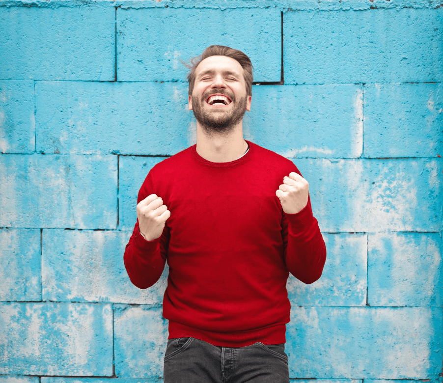 Happy man in red sweater
