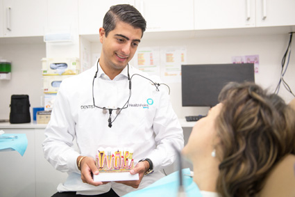 Dr Amir consulting with patient