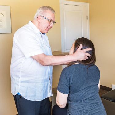 Doctor checking range of motion of neck