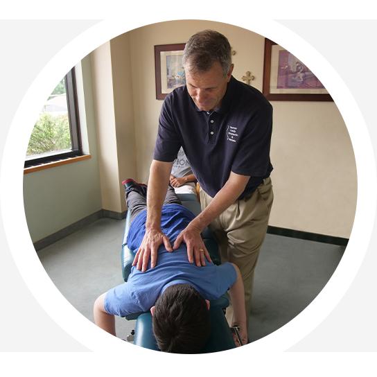Dr. Norman adjusting patient