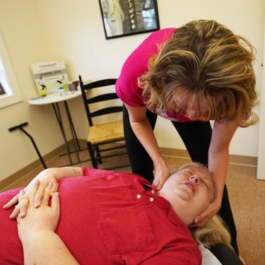 Dr. Erin adjusting woman
