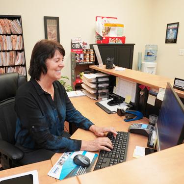 Receptionist working on computer