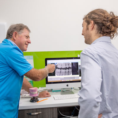 Dentist Discussing X-Ray