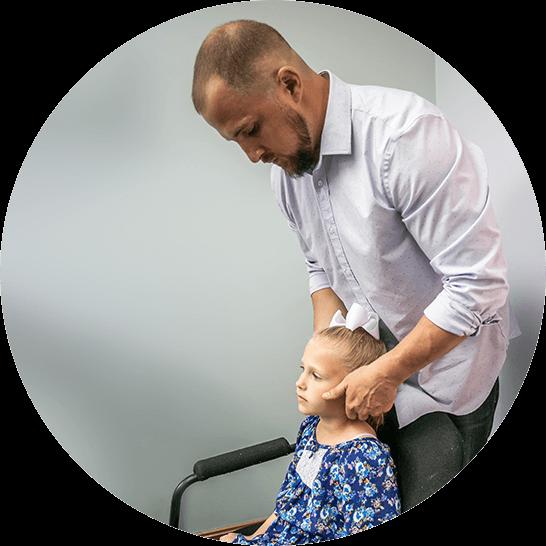 Dr. Mike adjusting patient