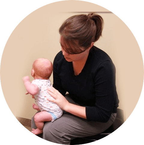 Chiropractor Woodbury, Dr. Amy holding baby