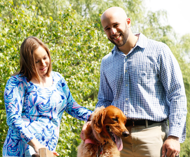 Dr. Eichner with his wife and dog