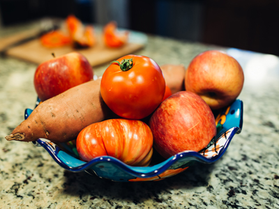 a bowl of fresh fruit and veggies