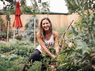 Nikki in the garden picking fresh veggies